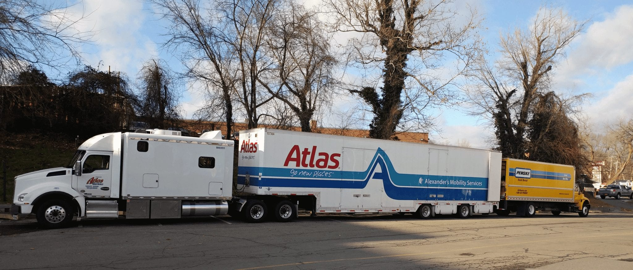 A photo of a full service mover off loading to a rental truck.